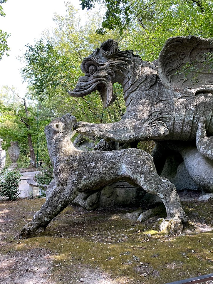 A stone statue of a dragon fighting off a lion